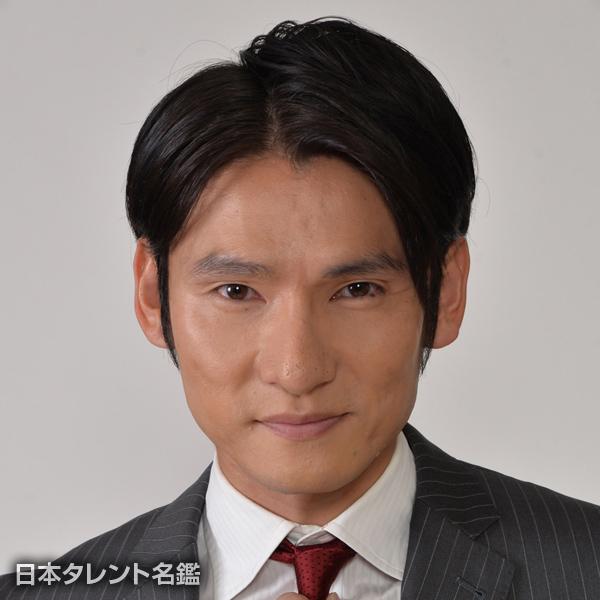津阪 雄一